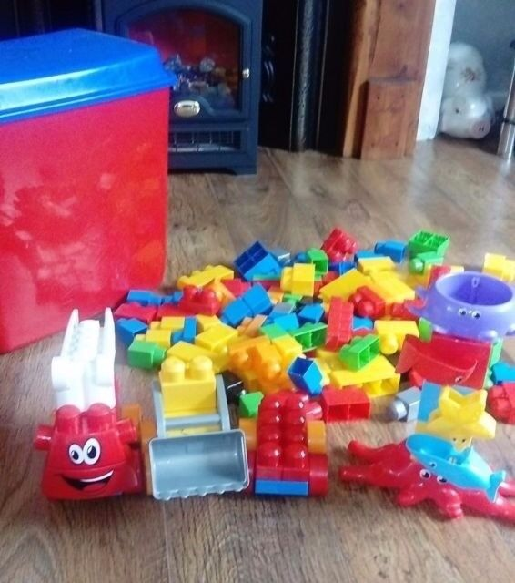Large collection of megablox, fire engine, digger extra wheels & bath toy.With large storage box too
