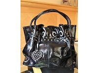 Russell and Bromley black patent leather handbag