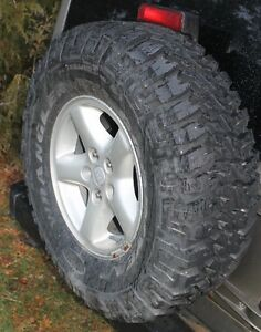 "0IIIII0 As New single 31"" MT/R on Jeep TJ rim 5 on 4.5 bolt"