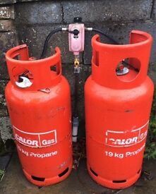 Propane gas cylinders and changeover regulator.