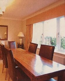 Dining room table and 6 Burgundy leather chairs. Matching sideboard in the same wood,