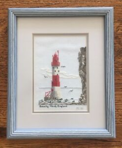 2 cross stitched lighthouses
