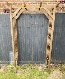 Wooden arch with trellis