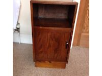 Dark wood bedside table with shelf recess and under cupboard