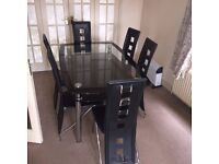 GLASS DINING TABLE AND 6 CHAIRS EXCELLENT CONDITION BUYER COLLECTS £75.00