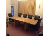 Solid Oak Dining Table with Two Extension Leaves.