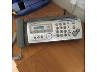 Telephone answering machine with fax