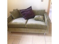 Stripped two seater sofa