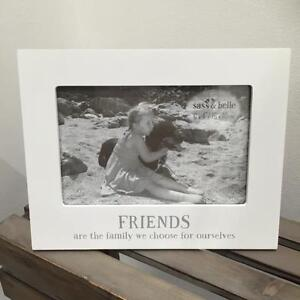 New WHITE PHOTO PICTURE FRAME with wording FRIENDS ARE THE FAMILY .......