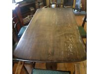 Original Ercol 1950's dining table and 6 chairs.