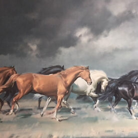 Painting of horses running across the plain