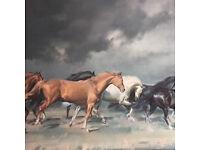Painting of horses running across the plain