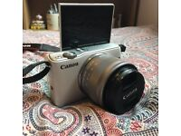 Canon EOS M10 DSLR Camera with EF-M 15-45 mm f/3.5-6.3 IS STM Lens (with battery and charger)