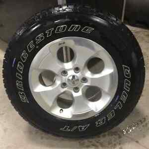 Set of 5 Tires and Rims for a Jeep Wrangler