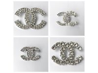 Chanel style diamonte brooches with pouch