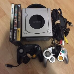 Nintendo GameCube with controllers and games