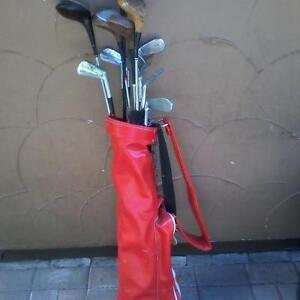 RED GOLF BAG WITH CLUBS/IRONS