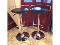 2 stylish black and silver bar stools. Practically brand new. sold as a pair. going cheap
