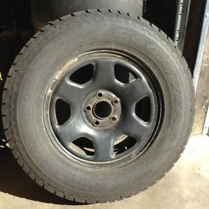 235 70 16 Goodyear Ultra Grip Snow Tires on Steel Wheels