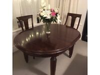 Extending, quality mahogany dining table and matching chairs set, North London