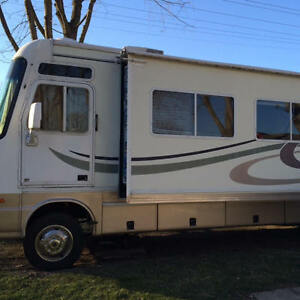 2000 damenn challenger Motorhome with slide