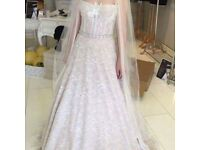 Beautiful size 8 wedding dress never worn