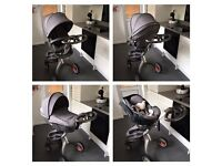 Stokke Xplory V4 with IZI Go Car Seat and other Accessories. WARRANTY UNTIL MAY 2018.