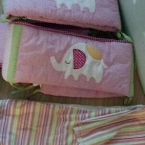 crib skirt with matching bumper pads- like new condition