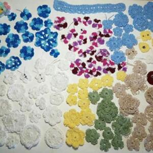 Large assortment of crochet mini flowers and some butterflies
