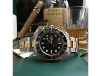 Rolex Submariner with Black Face And Black Ceramic Bezel with A TwoTone Strap Comes Rolex boxed