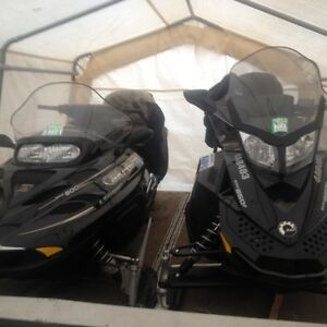 2 Like New Grand Touring Snow Machines and Trailer Package