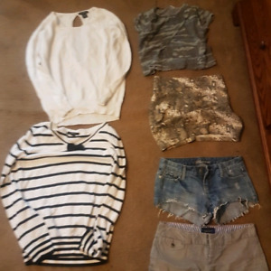 Assorted shirts shorts skirts and bathing suit tops