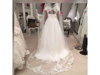 White Rose Size 20 wedding dress with poirier vail,used once