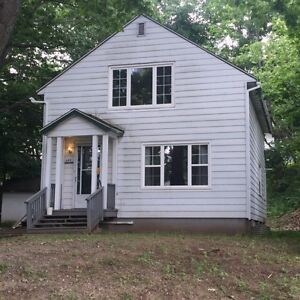 Two story home with basement apt, close to UNB and downtown