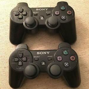 Two (2) Sony PlayStation ps3 controllers - black