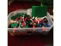 LEGO - large amount of assorted bricks including people, wheels, doors and windows