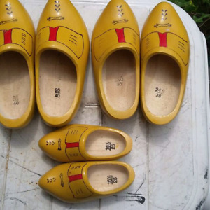 Three pairs of beautiful brand new wooden shoes from holland.