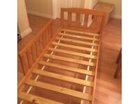 Childs first bed with side roll out panel