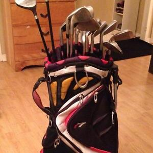 Men's golf clubs. 2 drivers, 1-9 irons, and 2 wedges w/bag.