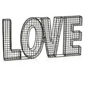 Large wire LOVE decor sign in black mesh.