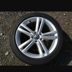 VW rims with tires.