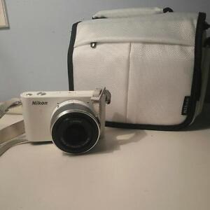 White Nikon 1 J1 Mirrorless Camera
