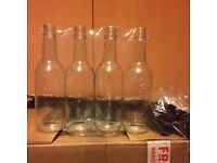 New Glass Wine bottles. Bought to make sloe gin and 16 unused left for homemade goods enthusiast.