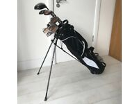 13 golf clubs, including putter and bag, in great condition (almost all irons Taylor Made brand)