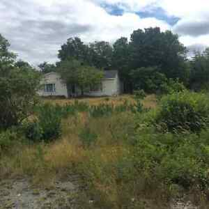 Large 3.5 acre lot which goes back 1000 Ft