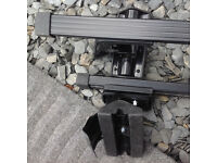 Two sets of roof rails / roof racksfor cars.