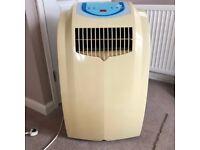 Portable dehumidifier / air conditioner