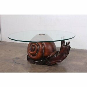 A hand-carved wooden snail table by Federico Armijo.