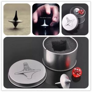 Zinc alloy spinning top with case and dice.