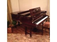 Grand Piano including piano stool and sheet music.